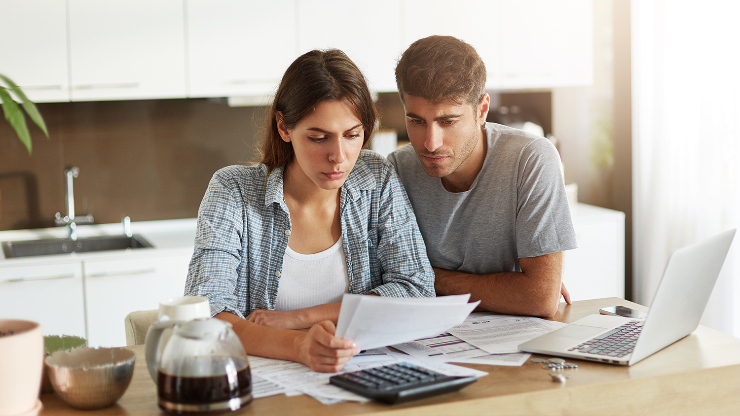Couple working with finances