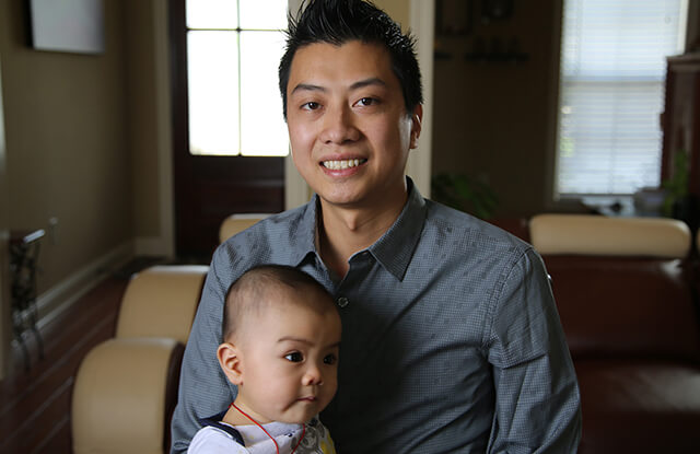Long Nguyen with his young son.