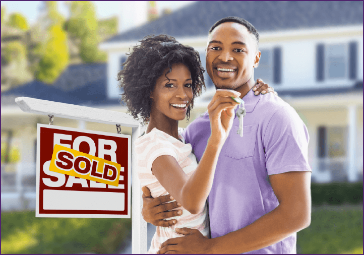 Man and woman smiling in front of new house