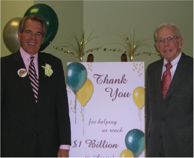 Illinois Mutual President Michel McCord and Chairman R.A. McCord celebrating $1 billion in assets.