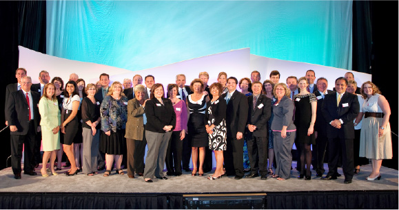 Group picture of Illinois Mutual employees celebrating the Company's 100th anniversary.