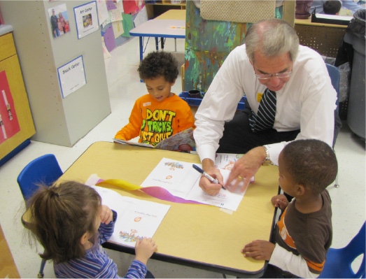 Michel McCord taking part in an educational volunteer activity on behalf of Illinois Mutual.