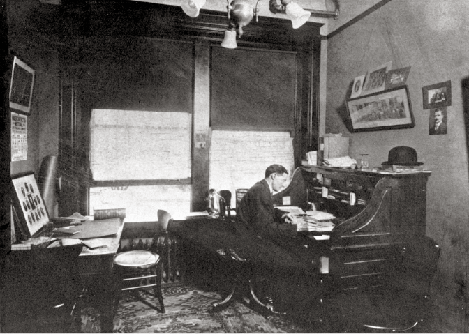 O.L. McCord working at his desk